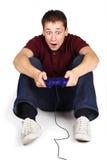 Man sitting on floor, holding joystick Royalty Free Stock Photography