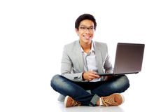 Man sitting on the floor with laptop Royalty Free Stock Image