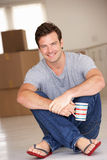 Man sitting on floor in new home  Royalty Free Stock Photography