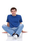 Man sitting on floor Stock Photos
