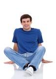 Man sitting on floor Stock Photos