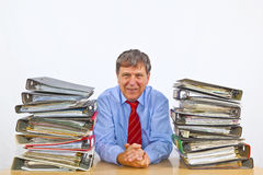 Man sitting between folders at a desk Stock Photos