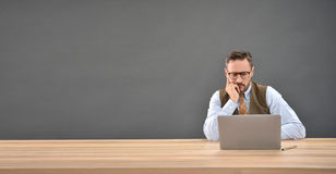 Man sitting in front of laptop computer Royalty Free Stock Images