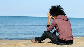 Man sitting in front of ocean sad Royalty Free Stock Photo