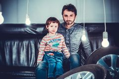 Man Sitting Beside Girl on Sofa Chair stock images