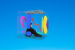 Man sitting in glass cubic Stock Photos
