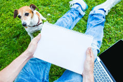 Man sitting on the green grass Stock Image