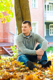 Man sitting on ground Stock Photo