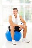 Man sitting gym ball royalty free stock image