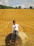 Man sitting on hay bale Royalty Free Stock Photos