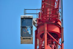 Man sitting high up in the sky in his crane Royalty Free Stock Photos