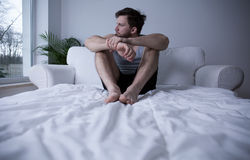 Man sitting on his bed Royalty Free Stock Photo