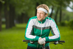Man sitting on his bicycle Stock Images