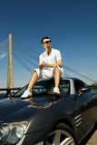 Man sitting on his car Royalty Free Stock Images