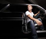 Man sitting in his car Royalty Free Stock Image