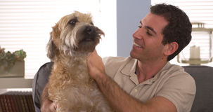 Man sitting with his dog Stock Image