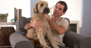 Man sitting with his dog Royalty Free Stock Image