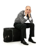Man sitting on his luggage. Handsome young man sitting on his luggage Stock Photography