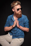 Man sitting and holding his palms together Royalty Free Stock Photos
