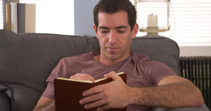 Man sitting at home writing in his journal Royalty Free Stock Images