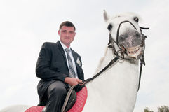 Man sitting on a horse Royalty Free Stock Photography