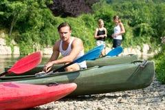 Man sitting by kayak Royalty Free Stock Photos