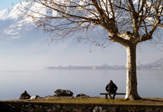 Man sitting by Lake Como stock photos