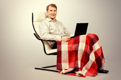 Man sitting with laptop Royalty Free Stock Photography