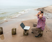 Man sitting with  laptop Royalty Free Stock Images