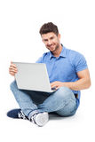 Man sitting with laptop Stock Photography