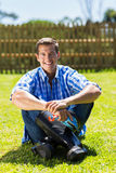 Man sitting lawn Royalty Free Stock Photos