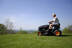 Man sitting on a lawnmower Royalty Free Stock Photo