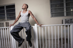 Man sitting on the ledge Stock Photography