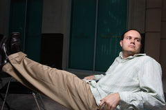 Man sitting with legs up Royalty Free Stock Images