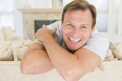 Man sitting in living room smiling Stock Photography