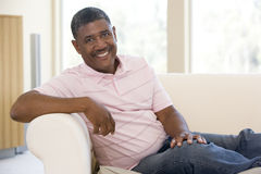 Man sitting in living room smiling Royalty Free Stock Images