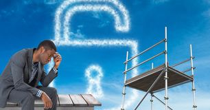 Man sitting by lock security cloud with  3D Scaffolding. Digital composite of Man sitting by lock security cloud with  3D Scaffolding Stock Photo