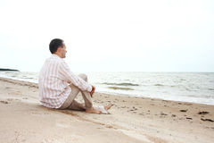 Man sitting and looking afar Royalty Free Stock Image