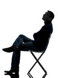 Man sitting looking up  silhouette full length Royalty Free Stock Photo