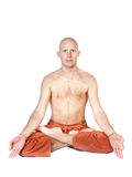 Man sitting in lotus pose isolated on white Stock Photo