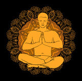 Man sitting in the lotus position doing yoga meditation Royalty Free Stock Images