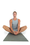 Man sitting in lotus position during a yoga session Stock Photography