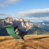 Man sitting in lounge chair Royalty Free Stock Photo
