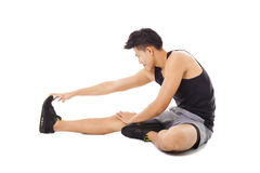 Man sitting and making stretching exercises Royalty Free Stock Photo