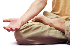 Man sitting in meditation position isolated. On white Stock Image