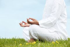 Man sitting in meditative lotus position Stock Images