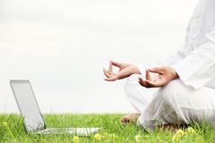 Man sitting in meditative lotus position Royalty Free Stock Image