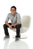 Man sitting on a modern chair Stock Images