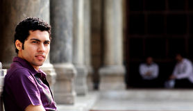 egyptian young man sitting in a mosque Royalty Free Stock Photography