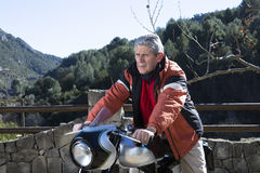 Man sitting on a motorbike Stock Photography